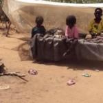 smiling children under shelter_0_0_8